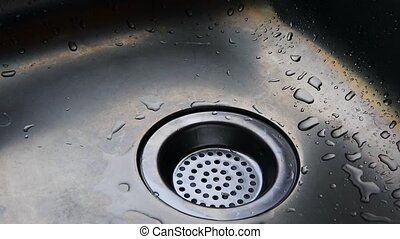 water gushing down in the sink