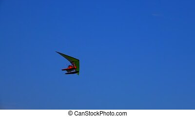 water hang glider flies in the clouds