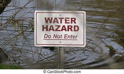 Water Hazard Sign  - Water Hazard sign on lake