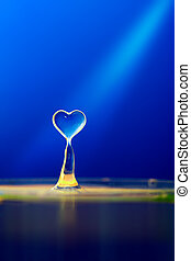 Water heart on blue background