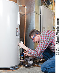 Water heater maintenance - A plumber is performing ...