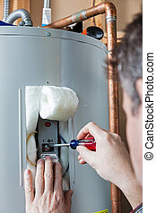 Water heater maintenance - A technician is performing...