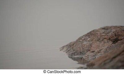 Water hitting rock too gentle
