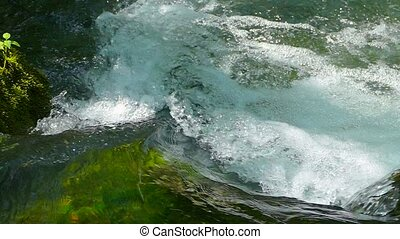 water in a fast mountain stream - Foaming water on rapids of...