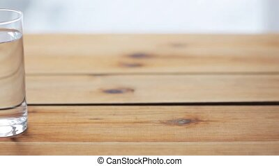 water in glass on wooden table