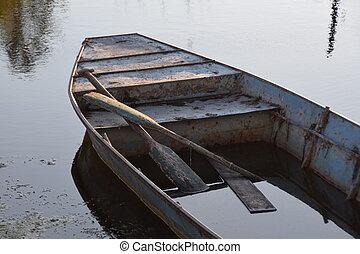 water in the boat, a boat on the water