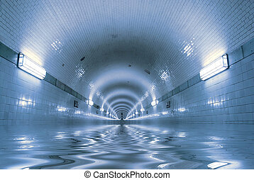 Water is coming... - Blue tunnel with water inside. The...
