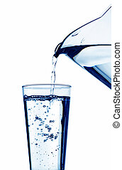 water is filled into a glass of water - pure and clean water...