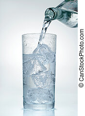 Water is poured into a glass - Water is poured into a Glass