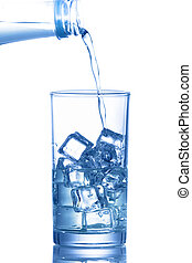 Water is poured into a glass with ice cubes