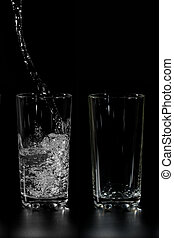 Water is poured into the two cups