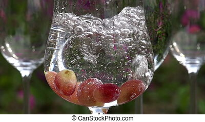 Water is Pouring into a Glass