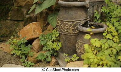 Water Jar Fountain - Water pours from a jar