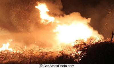 Water jet extinguishes huge fire at night