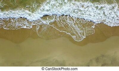 Water made by the waves comes ashore and goes to sea again....