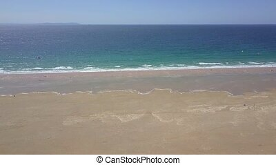 Water of ocean washing sands - Aerial remote shot of blue...