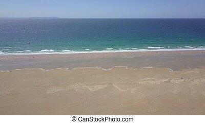 Water of ocean washing sands