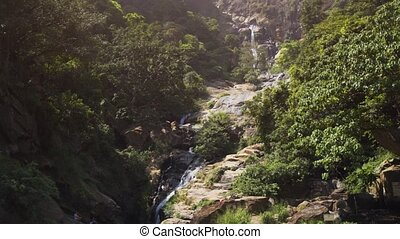 Water of Ravana Falls, Sri Lanka, Tumbling down its Rocky...