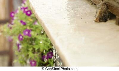 Water on granite plate