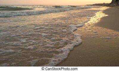 Water on seashore, close up.