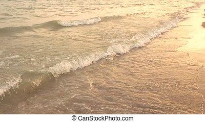 Water on seashore. Beach at eveningtime. Island in...