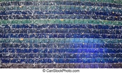Water over mosaic - Water running over colorful mosaic