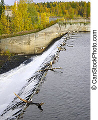 Water overflow on the man-made reservoir storage in the forest