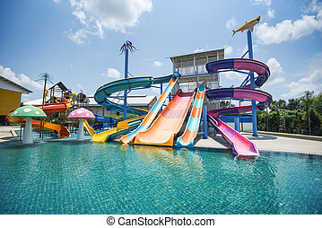 water park slide with swimming pool at amusement park - colored plastic water slides with pool in outdoor aqua park