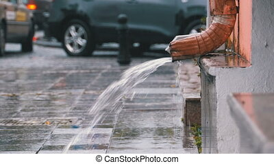 Water Pipe During the Rain. Tin Water Run Drain Pipe and...