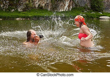 Water play by man and young woman.