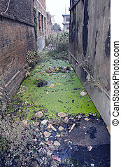 water pollution dirty with rubbish sewer canal in Nepal -...