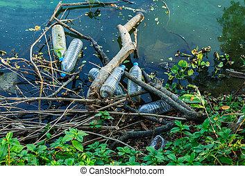 Water pollution, empty plastic bottles.