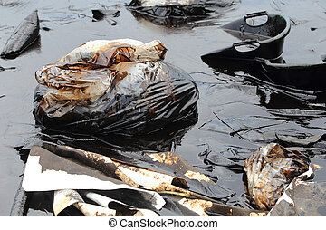 Water pollution - old garbage and oil patches on the surface