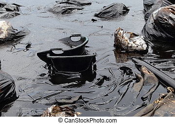 Water pollution - old garbage and oil