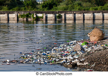 Water pollution - heavily polluted river inlet with various...