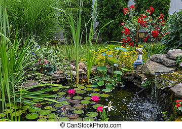 water pond with the statue - This is a close view of the ...