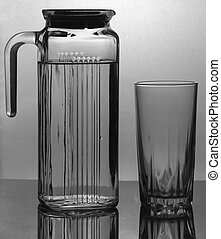 Water poured into a glass - Water poured from a bottle into...