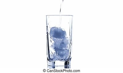 glass with ice cubes isolated - Water pouring into a glass...