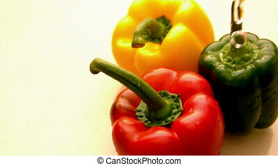 Water pouring on selection of peppers in slow motion