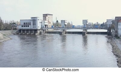 Water pouring through the Hydro Power Station Dam. - Water...