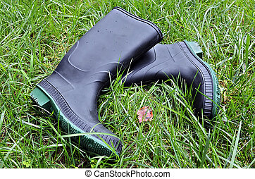 Water Proof Rubber Boots - A pair of rubber boots in the...