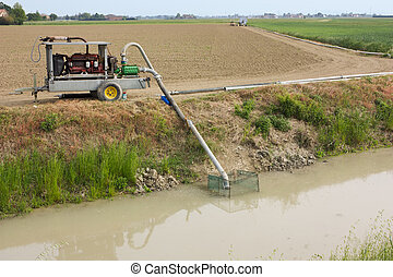 a irrigation pump sucks water from the canal to irrigate the fields