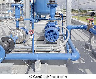 pump - Water pump and steel pipe.