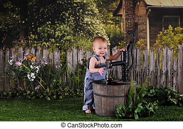 Water-Pump Baby - An adorable one-year-old happily playing...