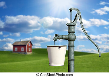 water pump and a red cottage house