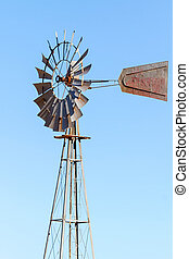 Water Pump Windmill on Blue Sky Background