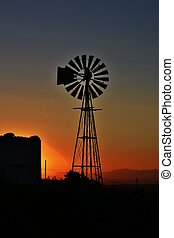 Water pump windmill - Landscape with water pump windmill at...