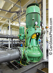 Industrial electric water pump and pipes.