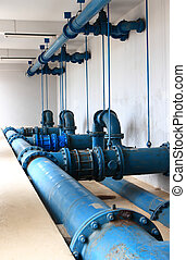 Water pumping station, industrial interior and pipes