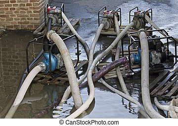 Industrial water pumps in pumping advancing floods.